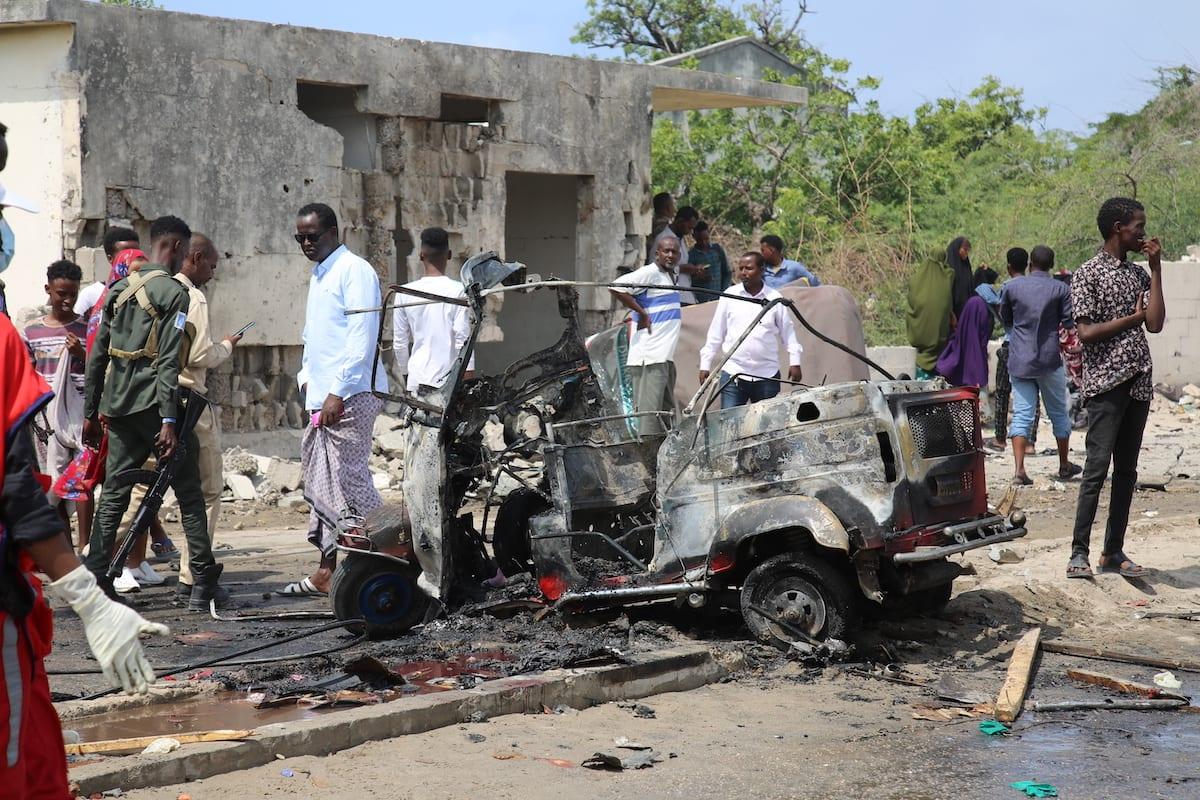 Damaged vehicles from a bomb that exploded in the Somali capital of Mogadishu on 10 July 2021 [Sadak Mohamed/Anadolu Agency]