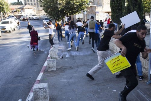 Israeli forces use tear gas to disperse protestors who stage demonstration in support of the Palestinian families who have been under threat of forcible eviction from their homes in Sheikh Jarrah neighborhood, in East Jerusalem on 17 July 2021. [Mostafa Alkharouf - Anadolu Agency]
