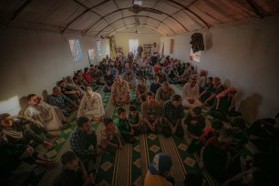 Syrians, those who were forced leave their homes due to Assad regime's attacks, perform Eid al-Adha prayer in a masjid at their camp in Idlib, Syria on July 20, 2021 [Muhammed Said/Anadolu Agency]