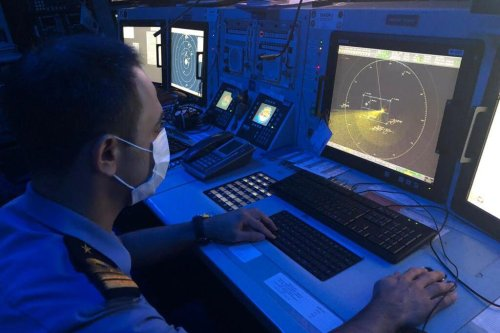 A military official checks the radar after it was reported that the boat containing 45 people sank 161 miles southwest of Antalya's Kas district, and search and rescue activities continue in the region on July 23, 2021. [MINISTRY OF NATIONAL DEFENCE OF TUR - Anadolu Agency]
