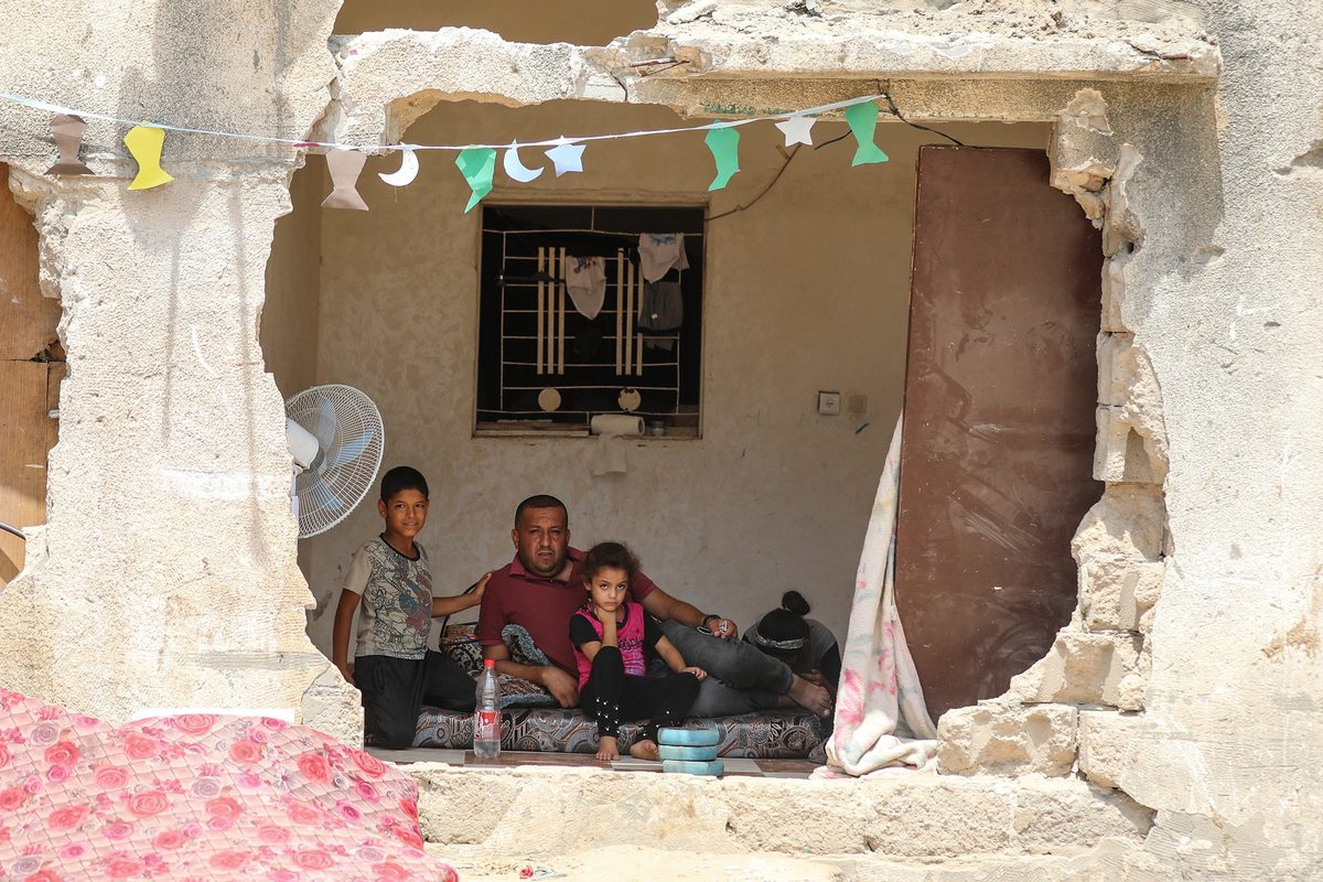 Palestinian families try to continue their life amid rubbles, damaged and destroyed buildings by Israeli attacks in Beit Hanoun, Gaza on 24 July 2021, as they hope their houses to be reconstructed. [Mustafa Hassona - Anadolu Agency]