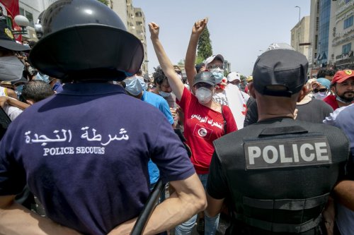 Tunisians stage a protest, demanding the resignation of the government and the dissolution of the parliament in Tunis, Tunisia on 25 July 2021 [Yassine Gaidi/Anadolu Agency]