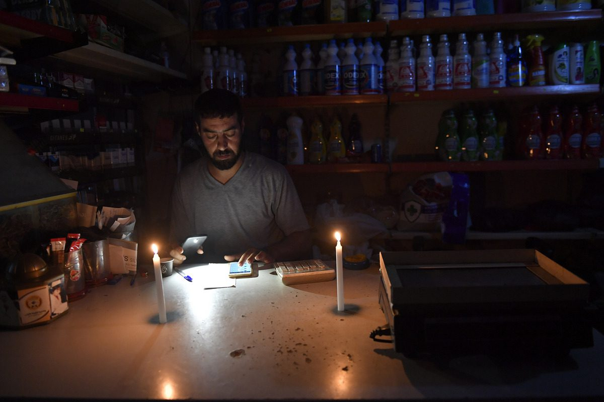 Lit candles during a power cut due to the fuel shortage in Beirut, Lebanon on July 25, 2021 [Houssam Shbaro/Anadolu Agency]
