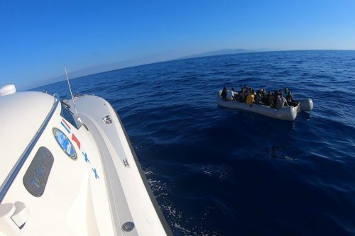Security teams rescue asylum seekers on a boat in Turkey on July 27, 2021 [Turkish Coast Guard/Anadolu Agency]