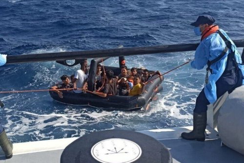 Security teams round up a total of 388 asylum seekers on a boat off Izmir's coast, while 2 others were detained over allegations of organizing the illegal crossing, in Turkey on July 27, 2021 [Turkish Coast Guard/Anadolu Agency]