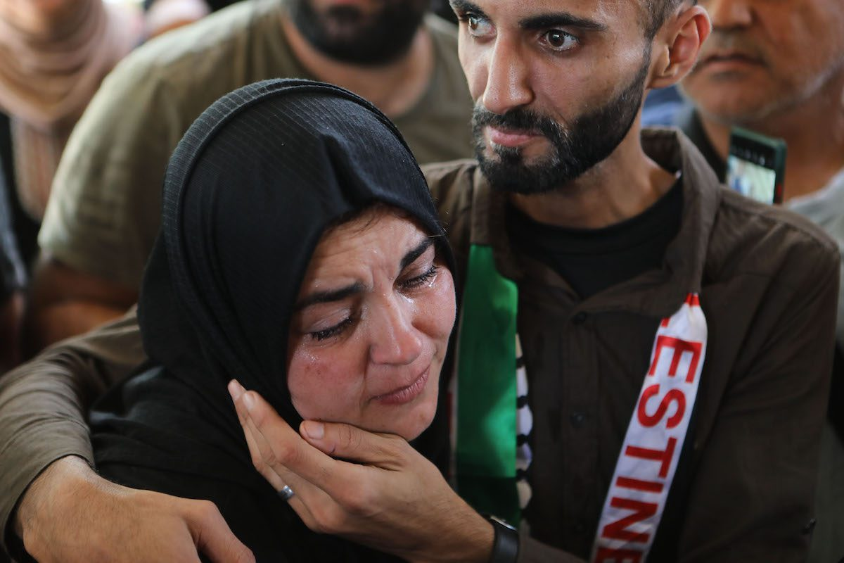 Relatives mourn during the funeral ceremony held for 12 year old Palestinian Mohammad al-Alaami who was shot by Israeli soldiers near the West Bank town of Beit Ummar in Hebron, West Bank on 29 July 2021. [Mamoun Wazwaz - Anadolu Agency]