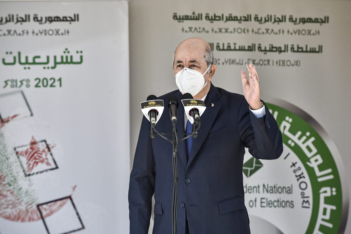 Algeria's President Abdelmadjid Tebboune speaks outside a polling station in Bouchaoui, on the western outskirts of Algeria's capital Algiers, on June 12, 2021 [RYAD KRAMDI/AFP via Getty Images]