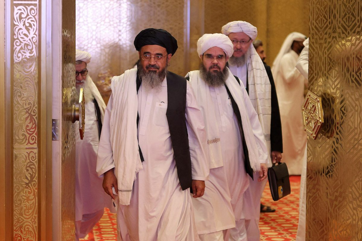 Members of the Taliban delegation arrive for the presentation of the final declaration of the peace talks between the Afghan government and the Taliban in Qatar's capital Doha on July 18, 2021. [KARIM JAAFAR/AFP via Getty Images]