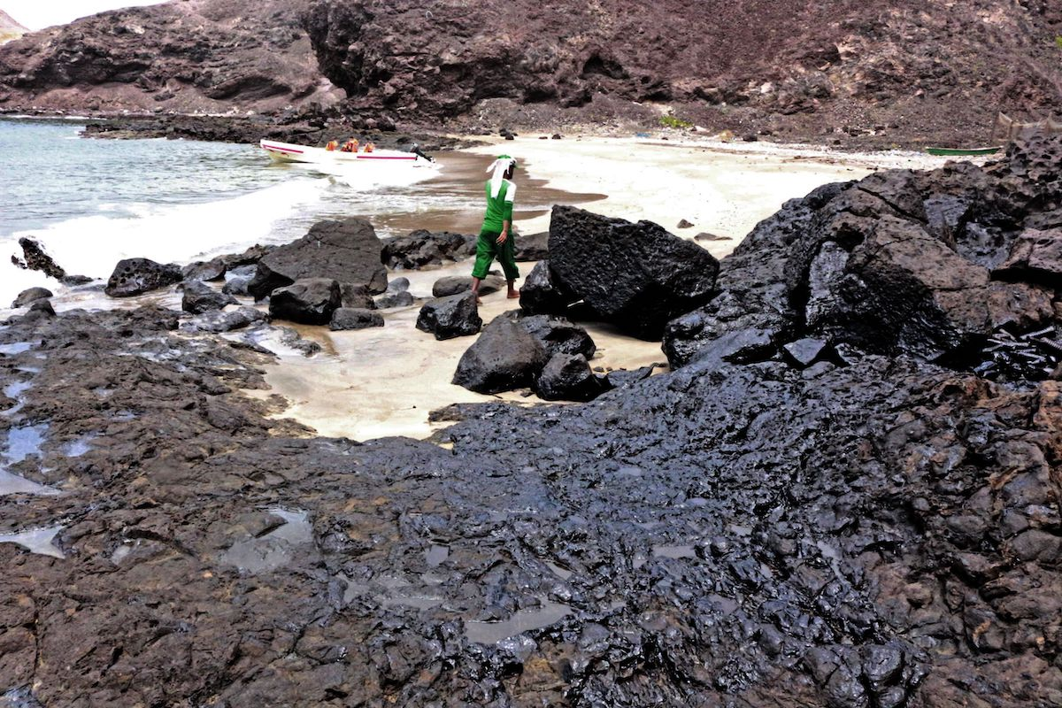 An oil contaminated beach is pictured after a tanker sank off the coast of Yemen's southern port city of Aden on July 21, 2021. [SALEH OBAIDI/AFP via Getty Images]