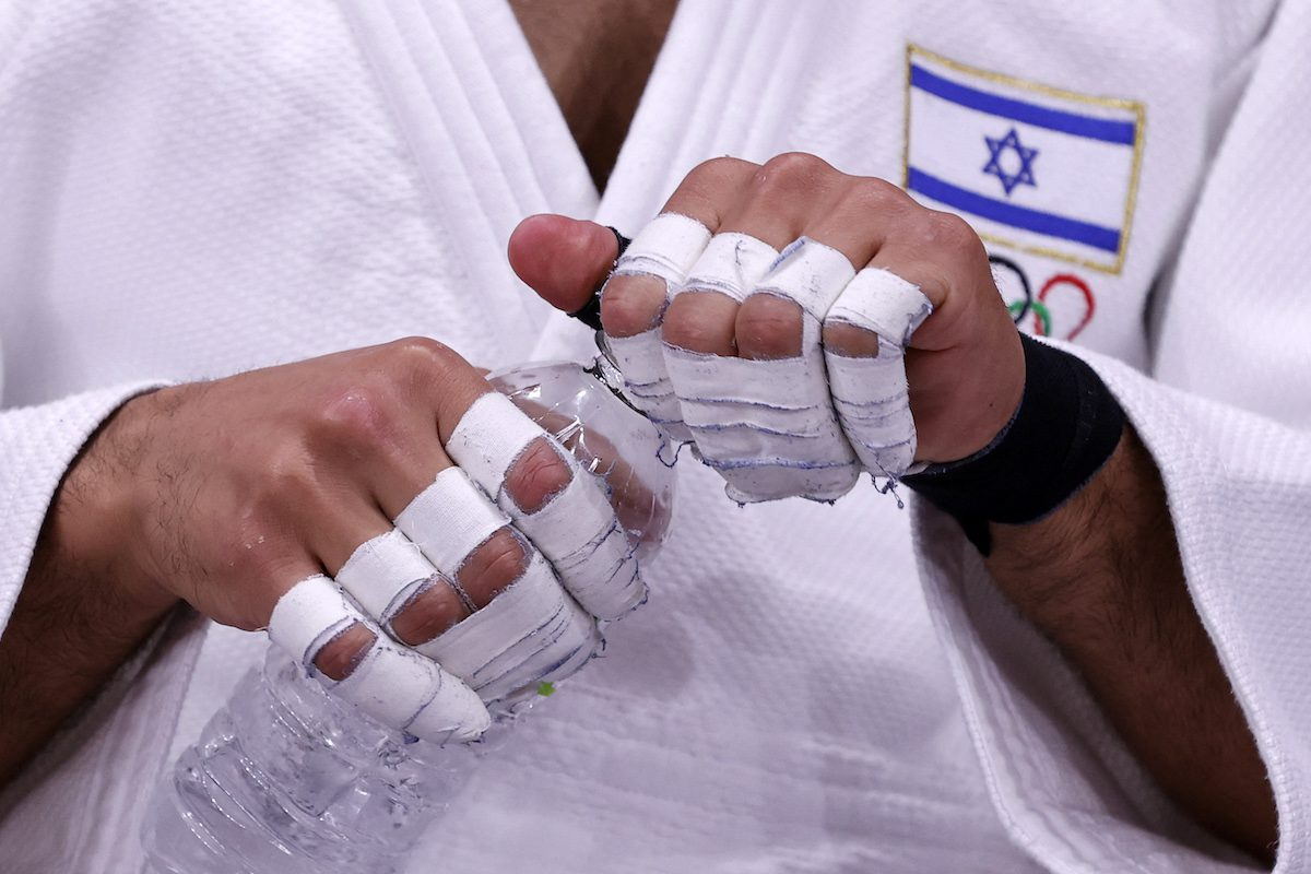 Israel's Tohar Butbul gets ready to compete in the judo men's -73kg elimination round bout during the Tokyo 2020 Olympic Games at the Nippon Budokan in Tokyo on July 26, 2021. [JACK GUEZ/AFP via Getty Images]