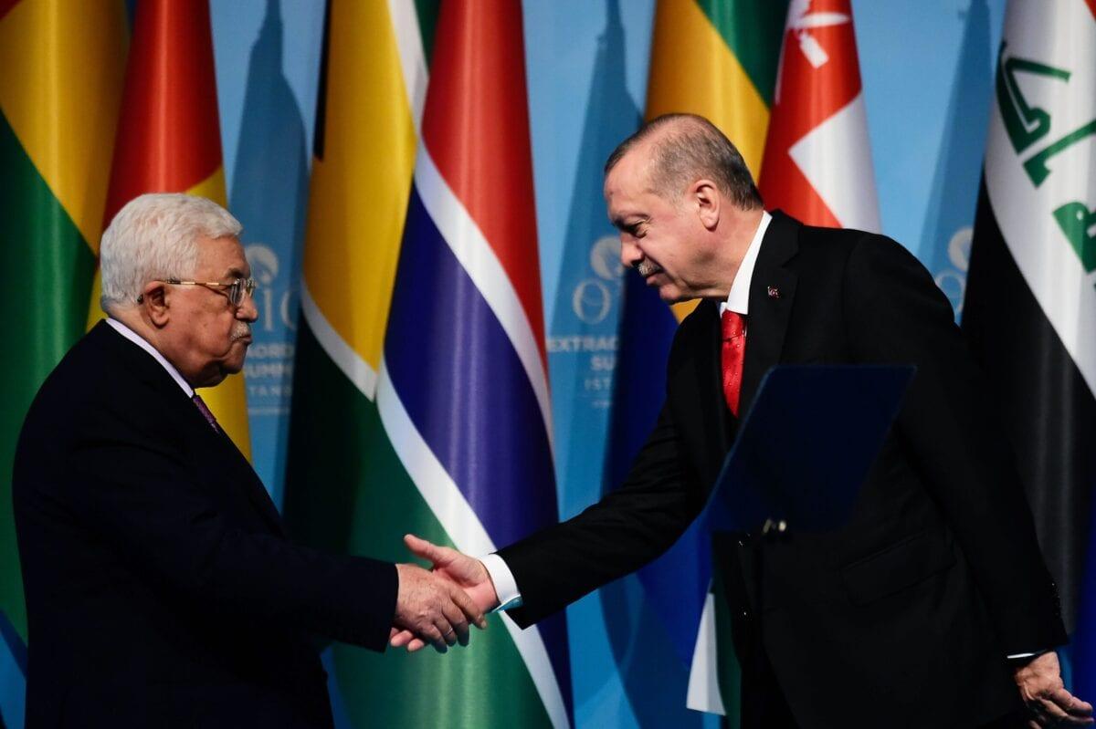 Turkish President Recep Tayyip Erdogan (R) shakes hands with Palestinian President Mahmoud Abbas (L) on December 13, 2017, in Istanbul [YASIN AKGUL/AFP via Getty Images]
