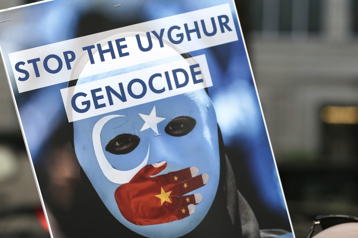 People demonstrate against China's policies towards Uyghur Muslims and other ethnic and religious minorities, who are suffering crimes against humanity and genocide, outside the Chinese Embassy in London, United Kingdom on 1 July 2021. [Hasan Esen/Anadolu Agency]