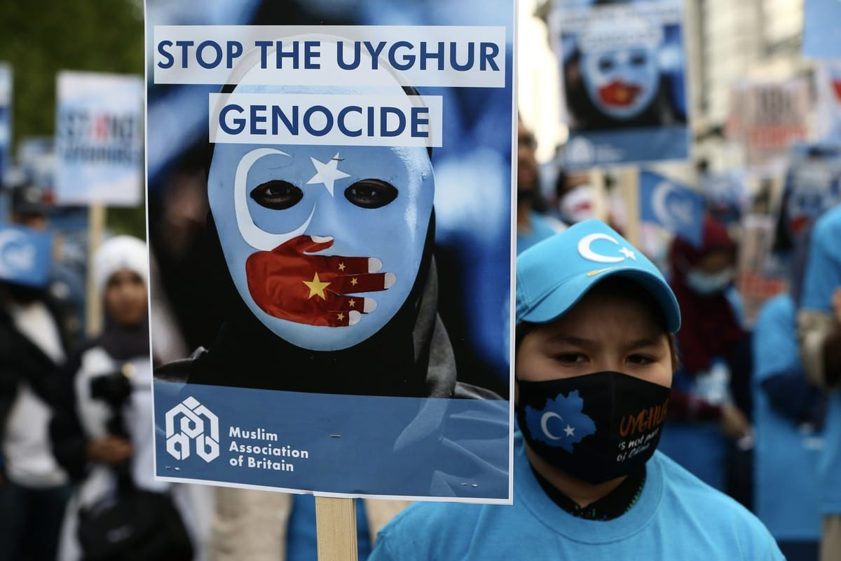 People demonstrate against China's policies towards Uyghur Muslims and other ethnic and religious minorities, who are suffering crimes against humanity and genocide, outside the Chinese Embassy in London, United Kingdom on 1 July 2021. [Hasan Esen - Anadolu Agency]