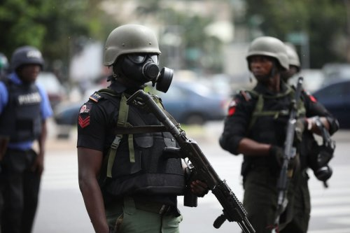 Policemen patrol the area in Abuja, Nigeria on 23 July 2019 [KOLA SULAIMON/AFP/Getty Images]