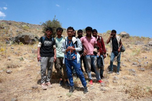 Afghan, Pakistani and Bangladeshi irregular migrants, who claimed they were left at the Turkey-Iran border after beaten by Iranian soldiers, in Bitlis, Turkey on July 27, 2021 [Şener Toktaş/Anadolu Agency]