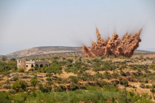 Smoke rises after Assad regime forces carried out an airstrike in Idlib, Syria on 29 July 2021 [Ahmet Hatip/Anadolu Agency]