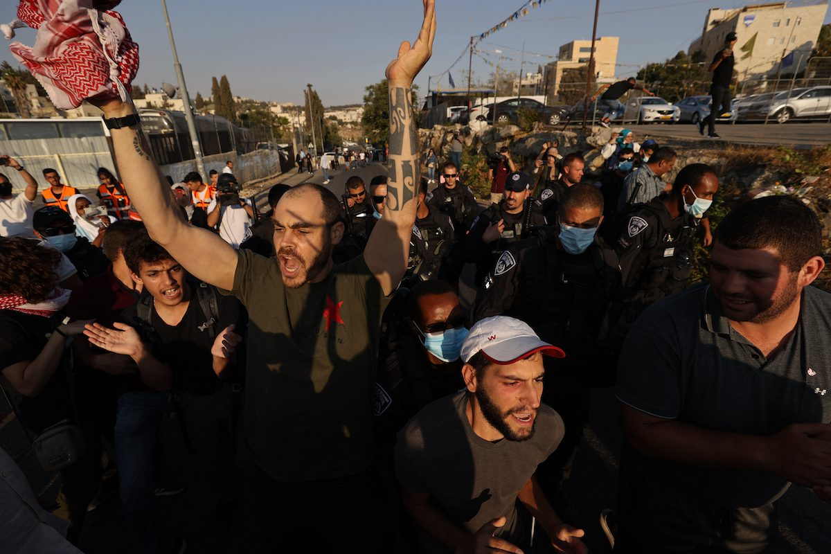 Israeli police intervene in demonstrators gathered in Sheikh Jarrah Neighborhood of Jerusalem to rally in support of Palestinian families at risk of being relocated on 31 July 2021 in East Jerusalem. [Mostafa Alkharouf - Anadolu Agency]
