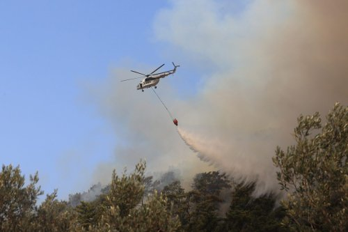 Helicopters battle the forest fire broke out in Marmaris district of Mugla as ground and aerial extinguishing operations continue on 1 August 2021 in Mugla, Turkey. [Mahmut Serdar Alakuş - Anadolu Agency]