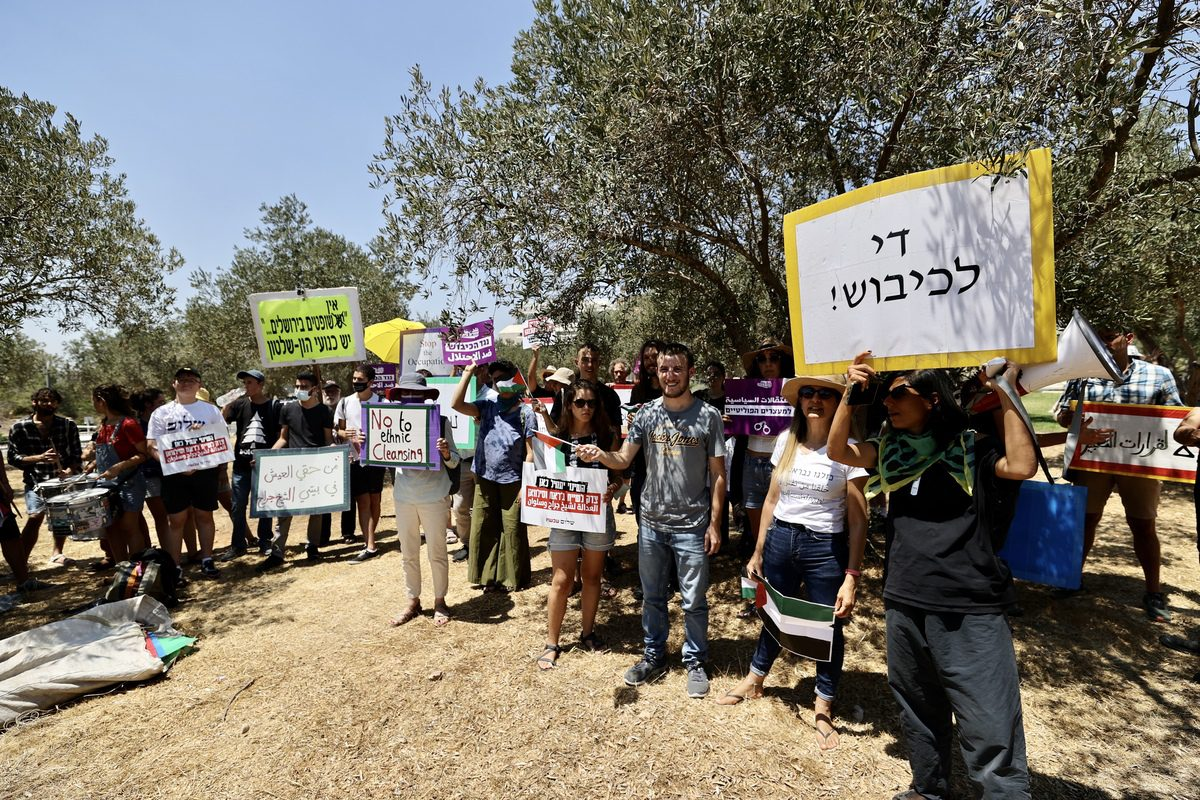 Palestinians stage a protest in front of the Supreme Court of Israel after the court's postponed its decision on the objection of the Palestinian families on forced eviction in Sheikh Jarrah on 2 August 2021 [Mostafa Alkharouf/Anadolu Agency]