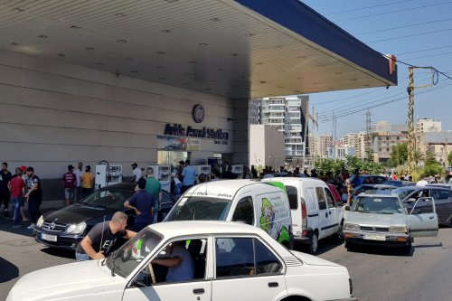 Lebanese people queue outside of a gas station to fill their vehicles amidst a deepening economic crisis sparking various shortages of basic staples in the country in Tripoli, Lebanon on14 August 2021 [Ahmed Said/Anadolu Agency]