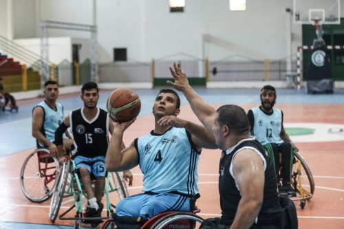 A view of the first match of the Wheelchair Basketball League, organized with the cooperation of the International Committee of the Red Cross and the Palestinian Paralympic Committee, in Gaza City, Gaza on August 15, 2021 [Mustafa Hassona/Anadolu Agency]