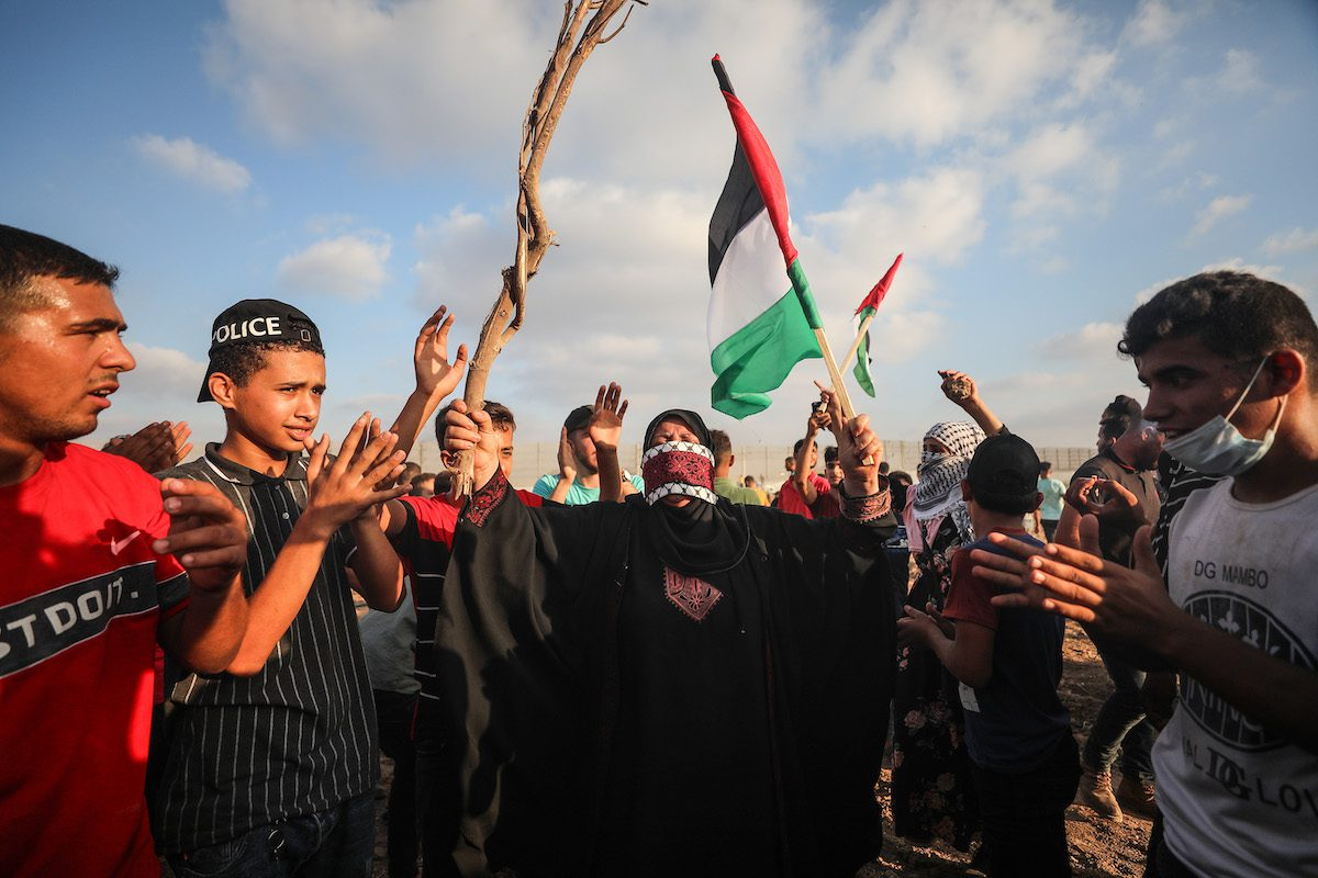 Palestinians stage a protest against Israel's siege in Gaza City, Gaza on 21 August 2021 [Mustafa Hassona/Anadolu Agency]