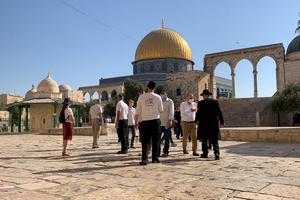 """JERUSALEM - AUGUST 25: (----EDITORIAL USE ONLY – MANDATORY CREDIT - """"JERUSALEM ISLAMIC WAQF / HANDOUT"""" - NO MARKETING NO ADVERTISING CAMPAIGNS - DISTRIBUTED AS A SERVICE TO CLIENTS----) Tens of fanatic Jews accompanied by Israeli police are seen at the courtyard of Al-Aqsa Mosque, in Jerusalem on August 25, 2021. ( JERUSALEM ISLAMIC WAQF - Anadolu Agency )"""