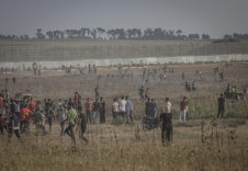 Palestinians protest at the Gaza-Israel fence on 21 August 2021 on the 52nd anniversary of the attempt to burn Al-Aqsa Mosque [Mohammed Asad/Middle East Monitor]