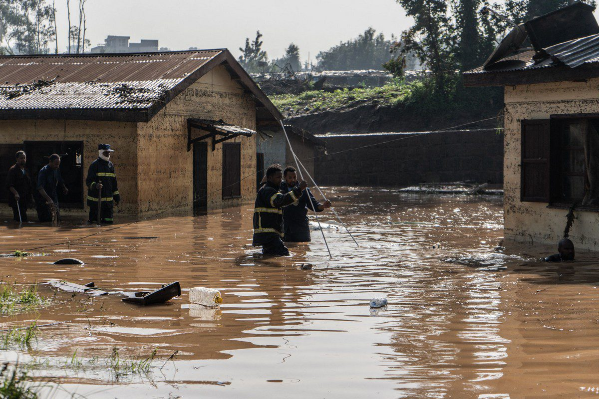 Fire fighters inspect damages caused by heavy rain which led to flood resident homes in Addis Ababa, Ethiopia, on 18 August 2021 [AMANUEL SILESHI/AFP/Getty Images]