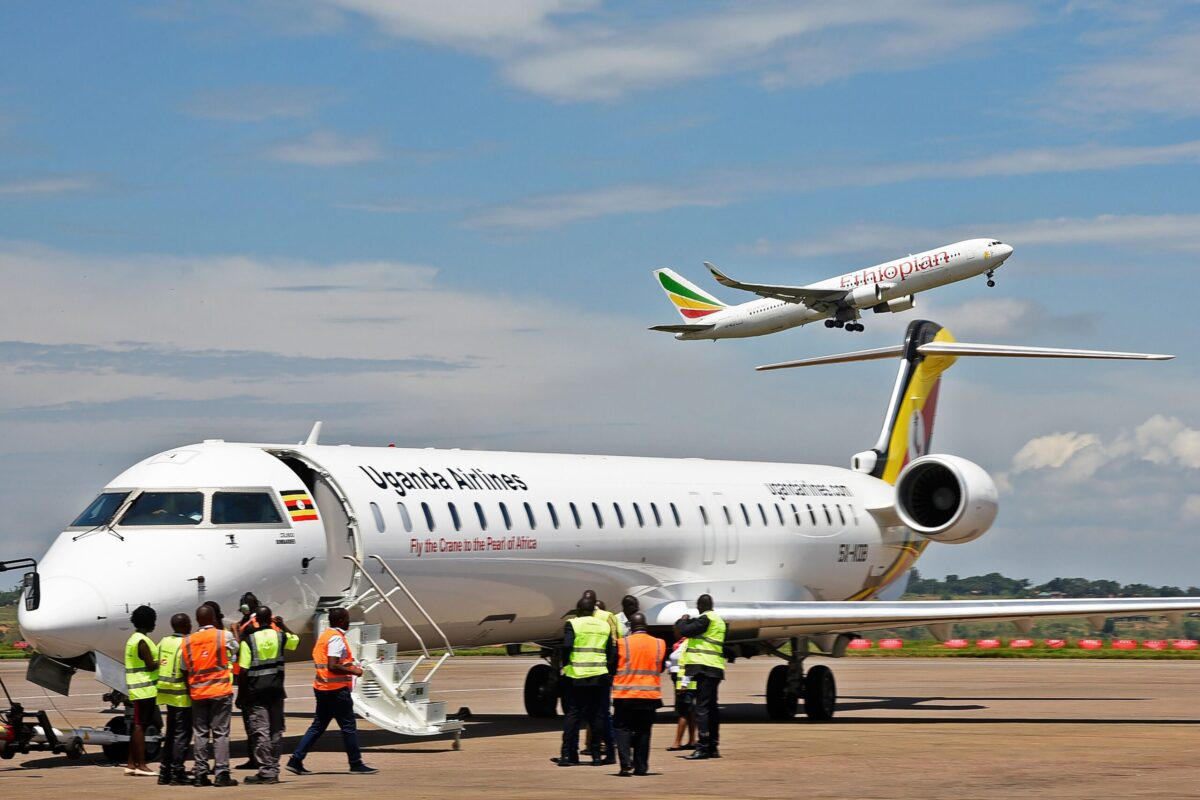 Ground crew prepare a Uganda Airlines Bombadier aircraft in Nairobi on August 27, 2019 [ISAAC KASAMANI/AFP via Getty Images]