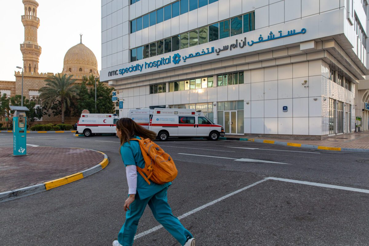 A health worker passes the NMC Speciality Hospital, operated by NMC Health Plc, in Dubai, United Arab Emirates, on Sunday, March 1, 2020 [Christopher Pike/Bloomberg via Getty Images]