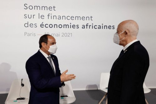 Egyptian President Abdel Fattah al-Sisi (L) speaks with Tunisia's President Kais Saied (R) before the opening session of the Summit on the Financing of African Economies on 18 May 2021 in Paris. [LUDOVIC MARIN/POOL/AFP via Getty Images]