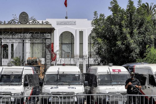 A member of Tunisia's security forces stands guard outside parliament headquarters in Bardo in Tunis on 31 July 2021. [FETHI BELAID/AFP via Getty Images]