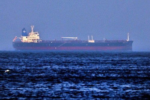A picture taken on August 3, 2021 shows the Israeli-linked Japanese-owned tanker MT Mercer Street, off the port of the Gulf Emirate of Fujairah in the United Arab Emirates. - On July 29, two crew members of the tanker MT Mercer Street, managed by a prominent Israeli businessman's company, were killed in what appears to be a drone attack off Oman, the vessel's London-based operator and the US military say, with Israel blaming Iran. (Photo by Karim SAHIB / AFP) (Photo by KARIM SAHIB/AFP via Getty Images)