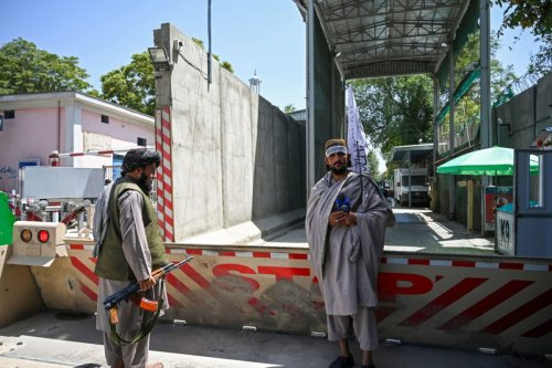 Taliban fighters stand guard at an entrance of the green zone area in Kabul on August 16, 2021 [WAKIL KOHSAR/AFP via Getty Images]
