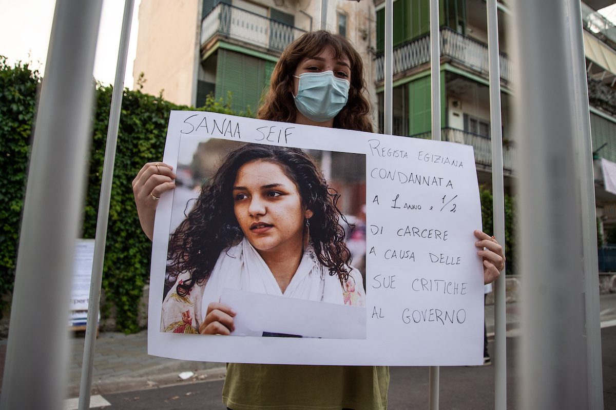 A woman shows a photograph of Sanaa Seif during a demonstration in solidarity with Patrick Zaki and human rights activists detained around the world on 16 June 2021 in Naples, Italy. [Ivan Romano/Getty Images]