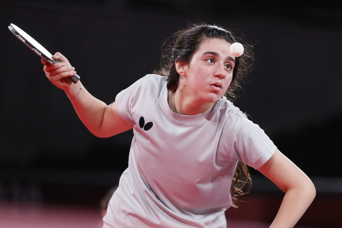 Hend Zaza of Team Syria in action during her women's singles preliminary round table tennis match on day one of the Tokyo 2020 Olympic Games at Tokyo Metropolitan Gymnasium on 24 July 2021 in Tokyo, Japan. [Steph Chambers/Getty Images]
