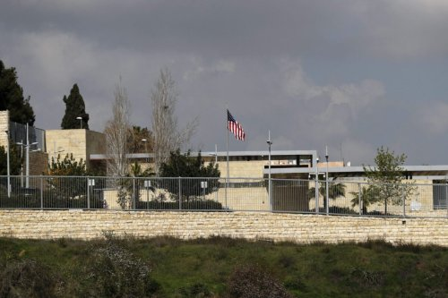 A picture taken on February 24, 2018, shows the US flag flying over the US consulate building complex in Jerusalem, which is considered one of the options to host the new US embassy headquarters after its relocation from Tel Aviv. The United States will move its embassy from Tel Aviv to Jerusalem in May 2018 to coincide with Israel's 70th Independence Day according to US officials. / AFP PHOTO / AHMAD GHARABLI (Photo credit should read AHMAD GHARABLI/AFP via Getty Images)
