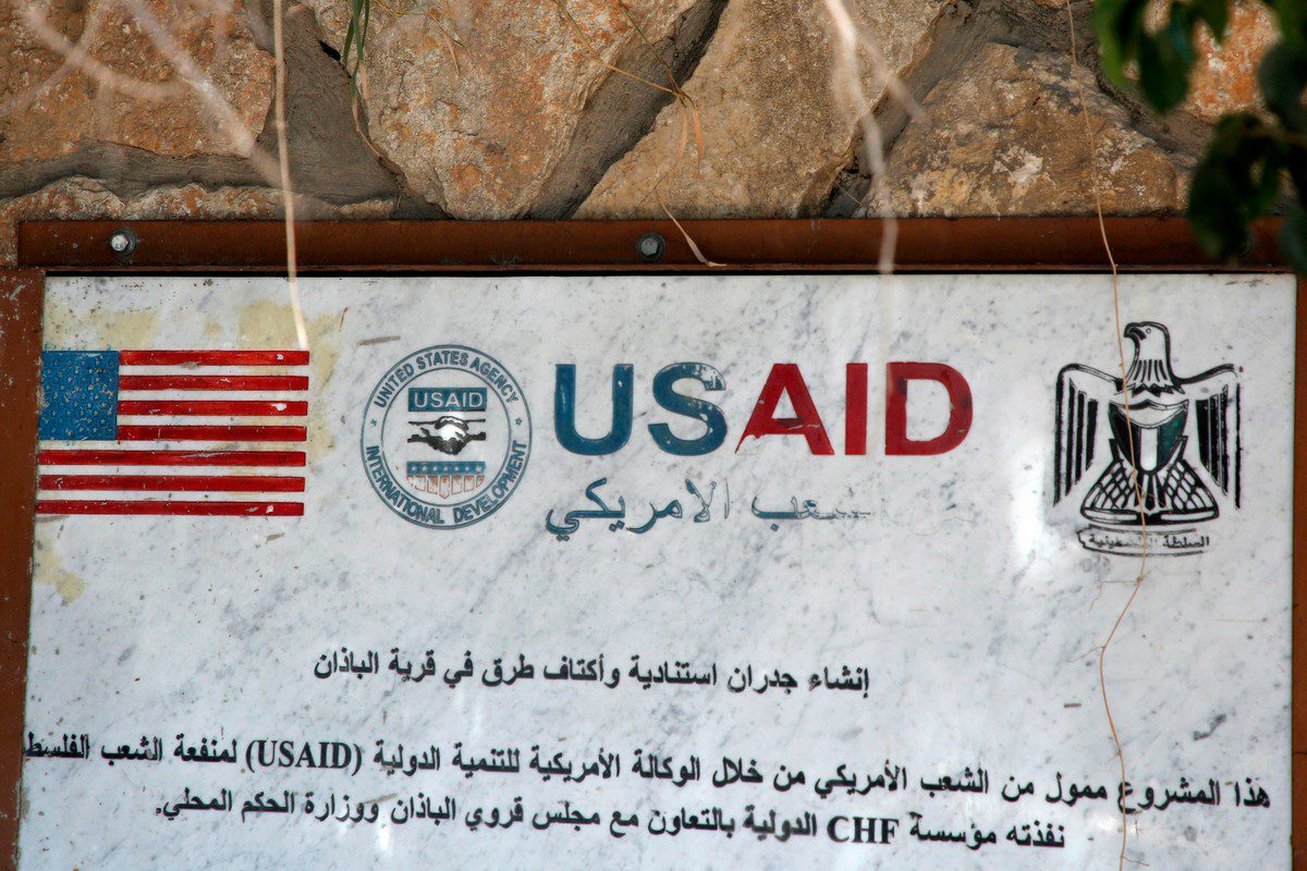 A USAID mural in occupied West Bank on 25 August 2018 [JAAFAR ASHTIYEH/AFP/Getty Images]