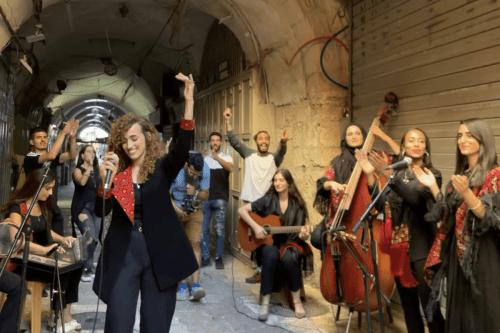 Aya Halaf performing traditional songs in the Old City of Jerusalem, August 2021 [Aya Halaf]