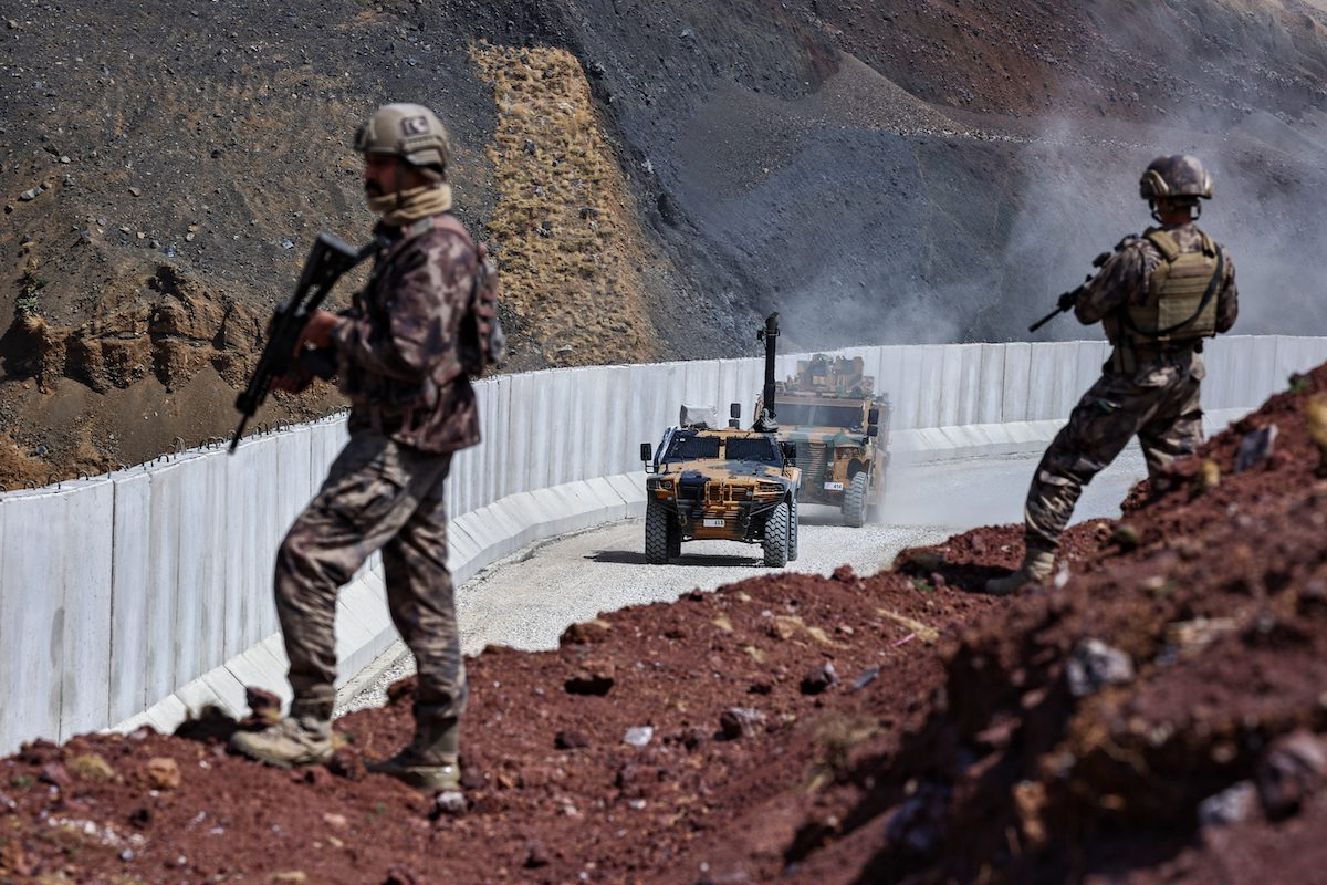Turkish soldiers and armoured vehicles patrol as construction works continue for the wall at the border with Iran in Caldiran district of Van, Turkey on September 05, 2021 [Özkan Bilgin / Anadolu Agency]
