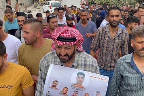 Palestinians stage a demonstration against violations on Palestinians at Israeli prisons, at Beit Al checkpoint in Jenin, West Bank on September 10, 2021. [Hisham K. K. Abu Shaqra - Anadolu Agency]