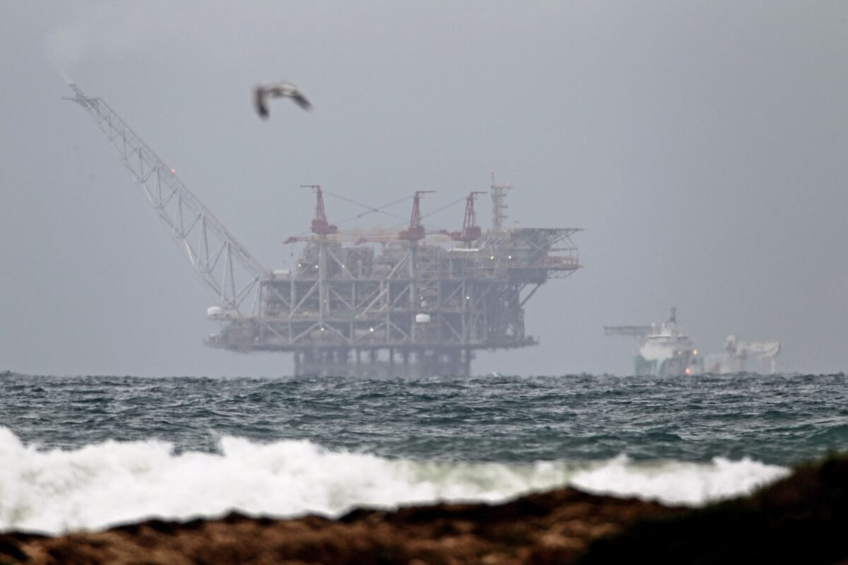 The platform of the Leviathan natural gas field in the Mediterranean Sea which started production today is pictured from the Israeli northern coastal city of Dor on December 31, 2019 [JACK GUEZ/AFP via Getty Images]