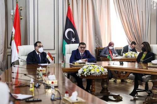 Libya's interim prime minister Abdul Hamid Dbeibah (C-R) meets with his Egyptian counterpart Mostafa Madbouly (C-L) and accompanying delegation at the prime minister's office in the capital Tripoli on 20 April 2021. [AFP via Getty Images]