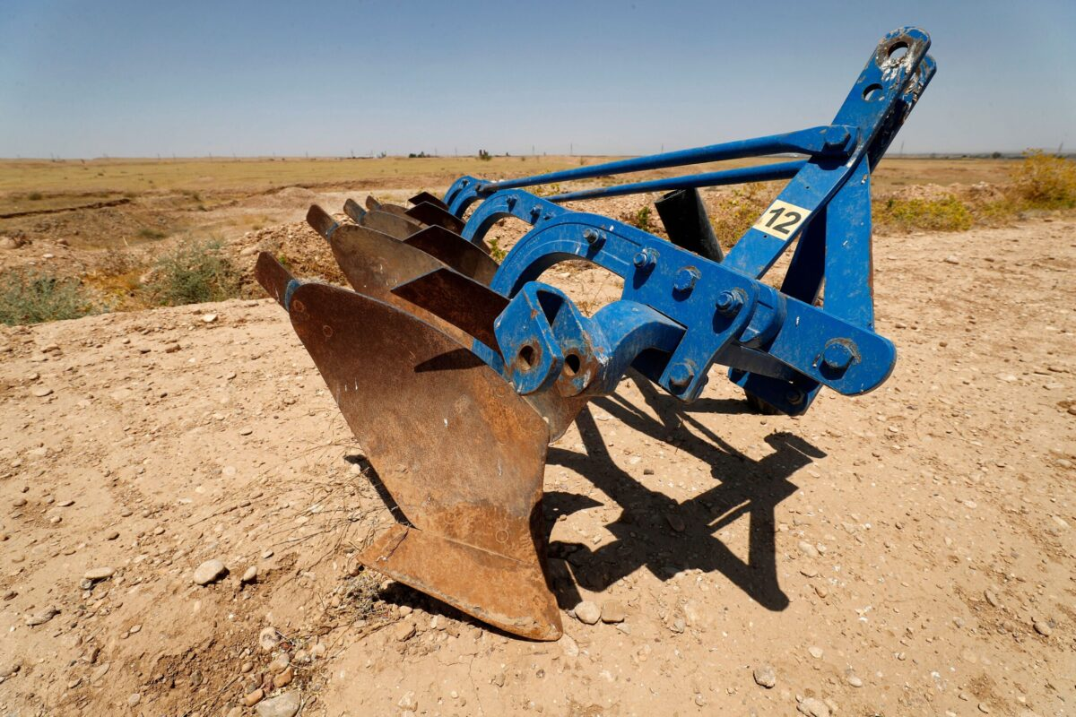This picture taken on June 24, 2021 shows a view of a plough in a dried up agricultural field in the Saadiya area, north of Diyala in eastern Iraq [AHMAD AL-RUBAYE/AFP via Getty Images]