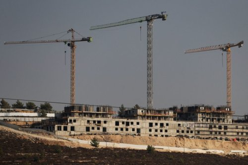 A picture taken on August 26,2021 shows construction works in the Jewish settlement of Givat Zeev, near the Israeli-occupied West Bank city of Ramallah [AHMAD GHARABLI/AFP via Getty Images]