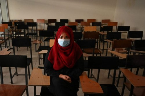 A student sits inside a classroom after private universities reopened in Kabul on September 6, 2021. - Women attending private Afghan universities must wear an abaya robe and niqab covering most of the face, the Taliban have ordered, and classes must be segregated by sex -- or at least divided by a curtain. (Photo by Aamir QURESHI / AFP) (Photo by AAMIR QURESHI/AFP via Getty Images)
