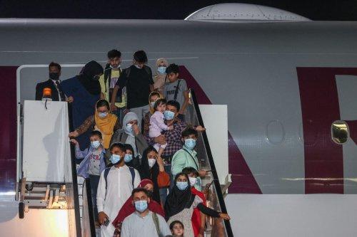 Evacuees from Afghanistan arrive at Hamad International Airport in Qatar's capital Doha on September 10, 2021 [KARIM JAAFAR/AFP via Getty Images]