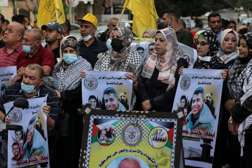 Supporters of the Fatah movement demonstrate to support the six Palestinian prisoners, who escaped from Israel's Gilboa prison, in front of the Red Cross headquarters in Gaza City on September 11, 2021 [MAHMUD HAMS/AFP via Getty Images]