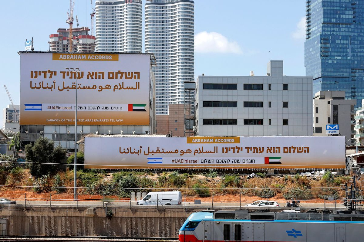 Billboards by the United Arab Emirates Embassy marking the signing of the US-brokered Abraham Accords are seen along the expressway in the Israeli coastal city of Tel Aviv on 14 September 2021. [JACK GUEZ/AFP via Getty Images]